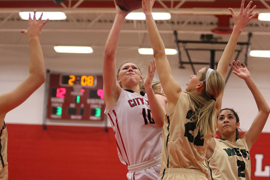 Ashley Joens '18 shoots over a West High defender in the first quarter.