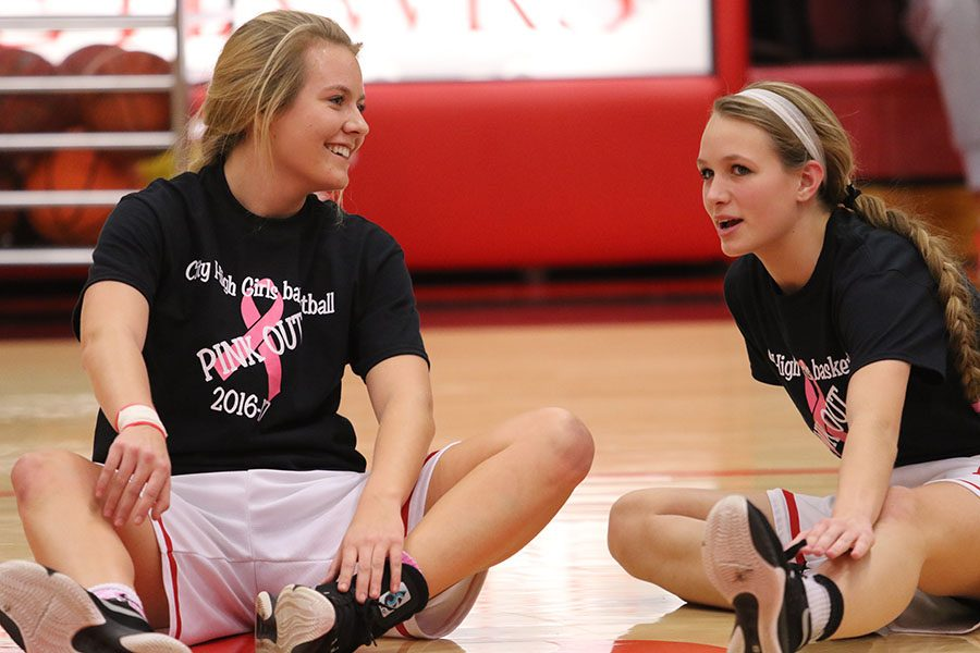 Mikayla Lacey '17 and Sydney Schroder '17 warm up before City took on West.