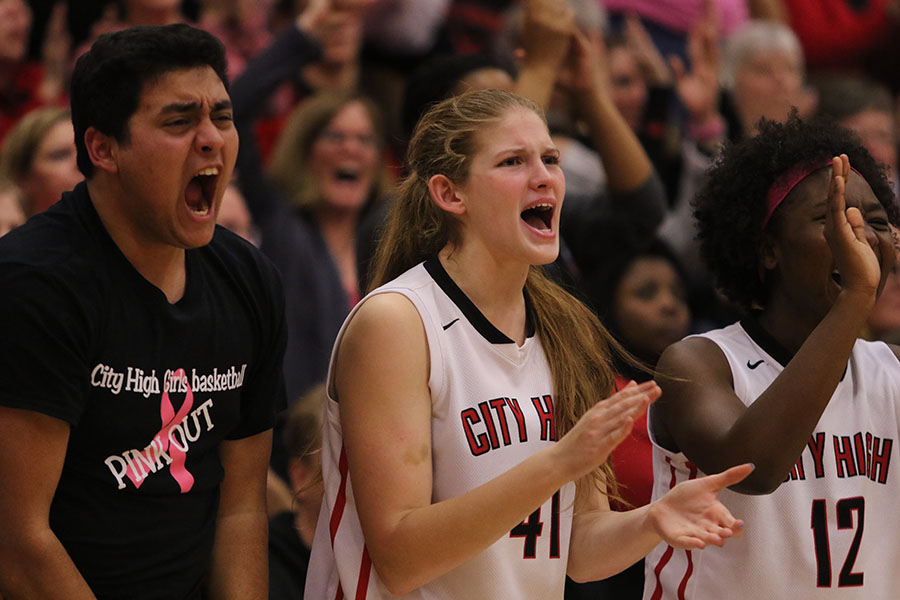 Manager Sameer Ali '17 and teammate Skye Spencer '18 react after a City High basket.