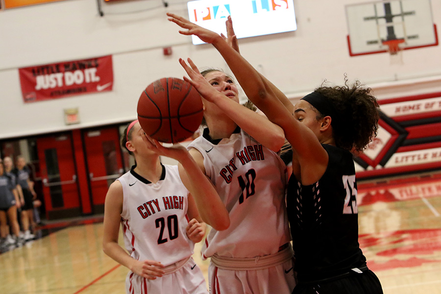 Ashley Joens '18 goes up for a shot while being guarded by Ankeny Centennial's Keanna Williams '18.