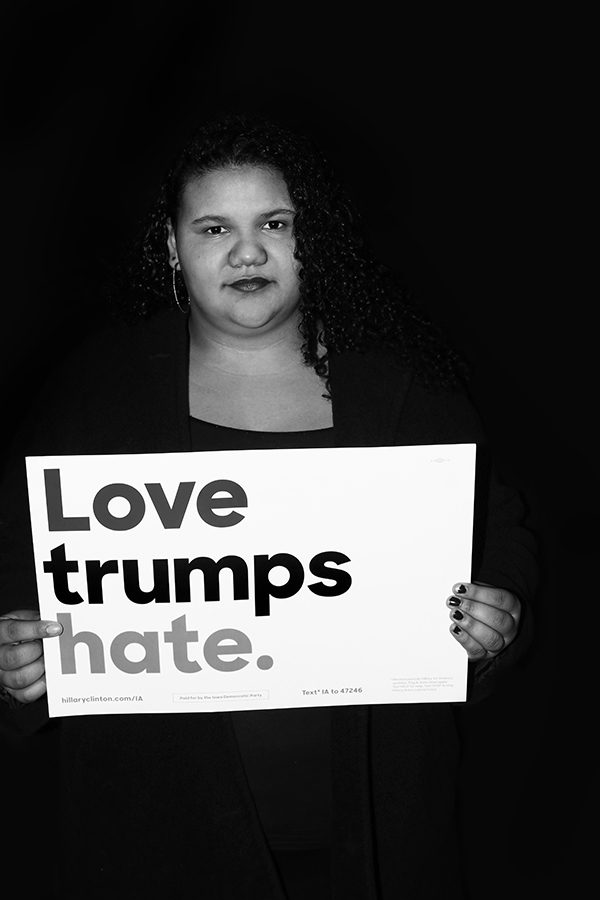 Destanie+Gibsen+%2720+poses+with+a+sign+reading++%22Love+trumps+hate.%22+-Photo+by+Danielle+Tang
