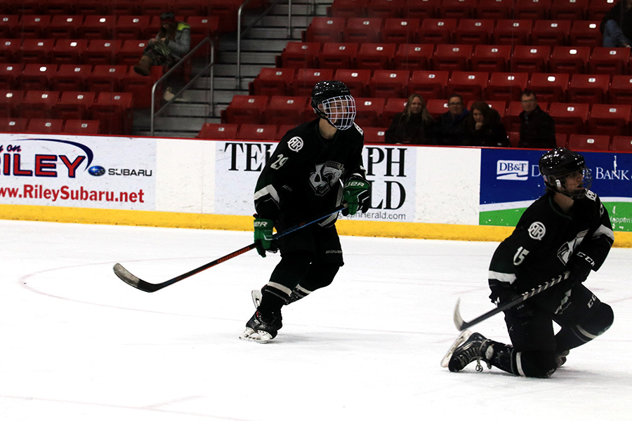 Matthew Taylor '20 skates down the ice during a game in Dubuque on Saturday, February 4th.