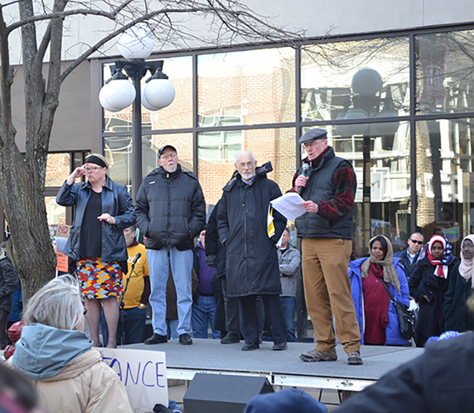 Iowa City Mayor Jim Throgmorton addresses protesters in Iowa City's ped mall, February 5.