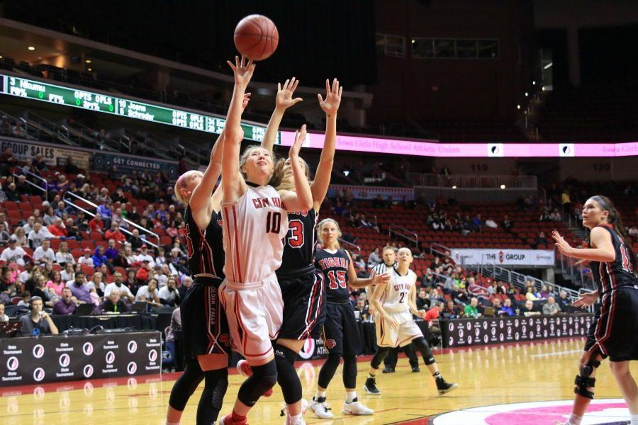 City High's Ashley Joens '18 goes up for a layup in the first half against Cedar Falls.