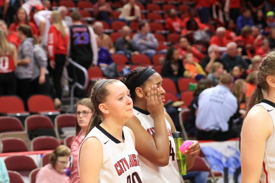 City High's Aubrey Joens '20 (#20) and Kenya Earl '17 react after losing to Cedar Falls in the first round of the state tournament.