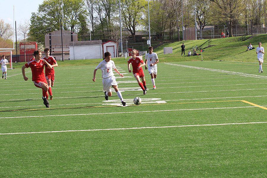 Cameron Chavez '18 dribbles towards the goal.
