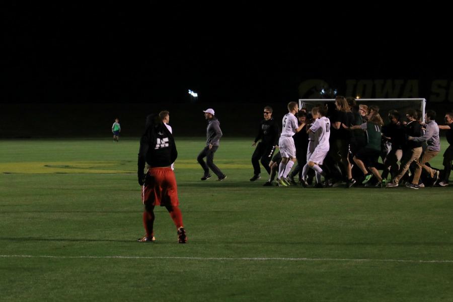 City High's Imata Mwenekamba '17 walks off the field as West High fans storm the field in celebration.