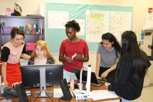 Fashion class students and co-teacher Elizabeth collaborate on the May fashion show