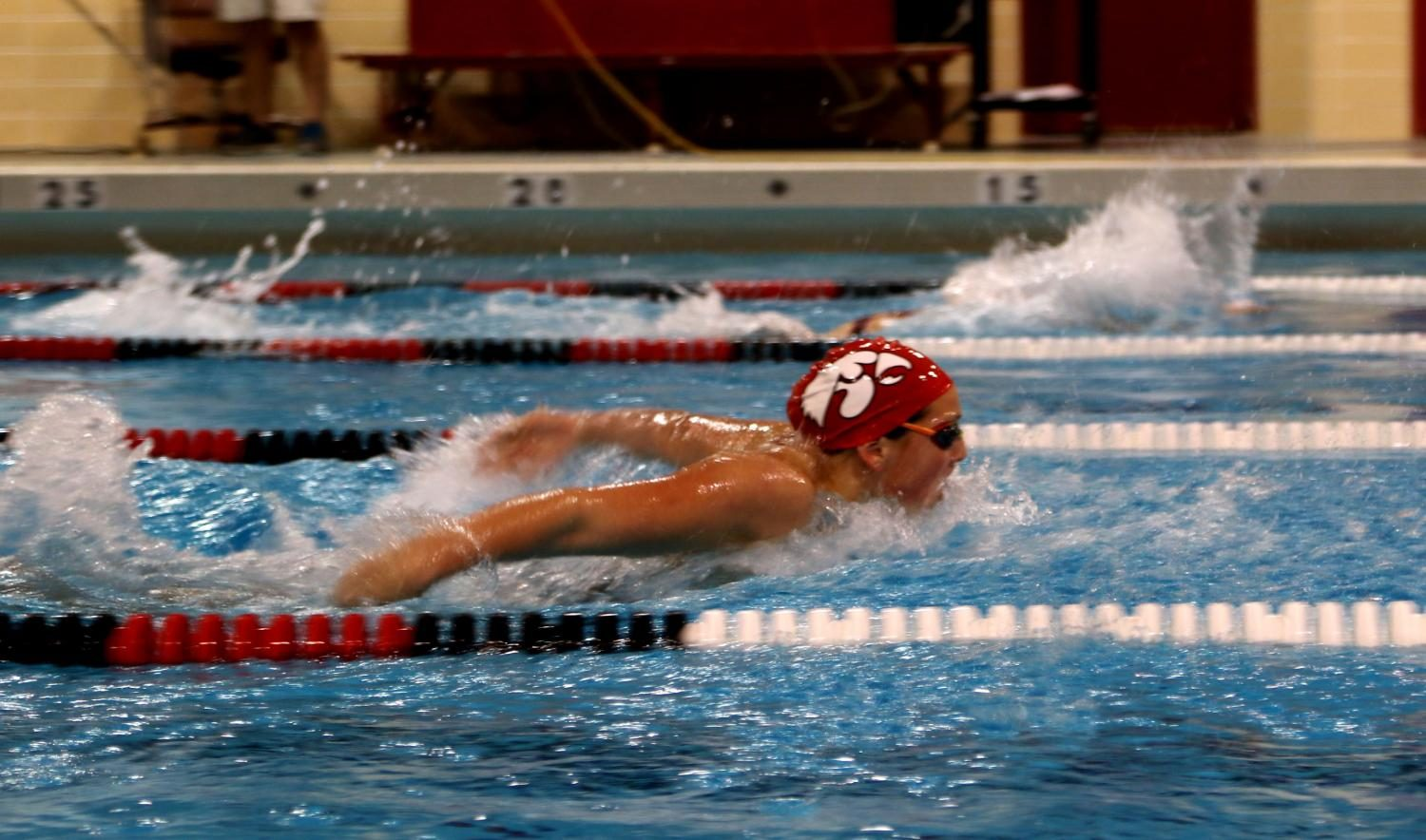 Trinity Sadecky competes in the 100 Fly