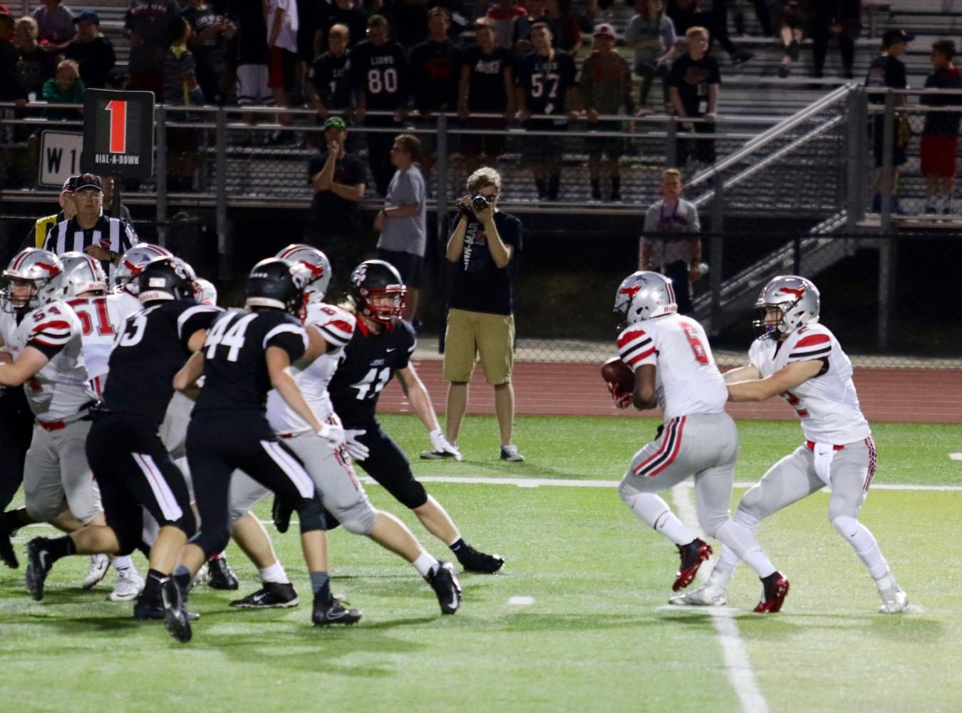Bryce Hunger 18 hands the ball off to teammate Devontae Foster 18.