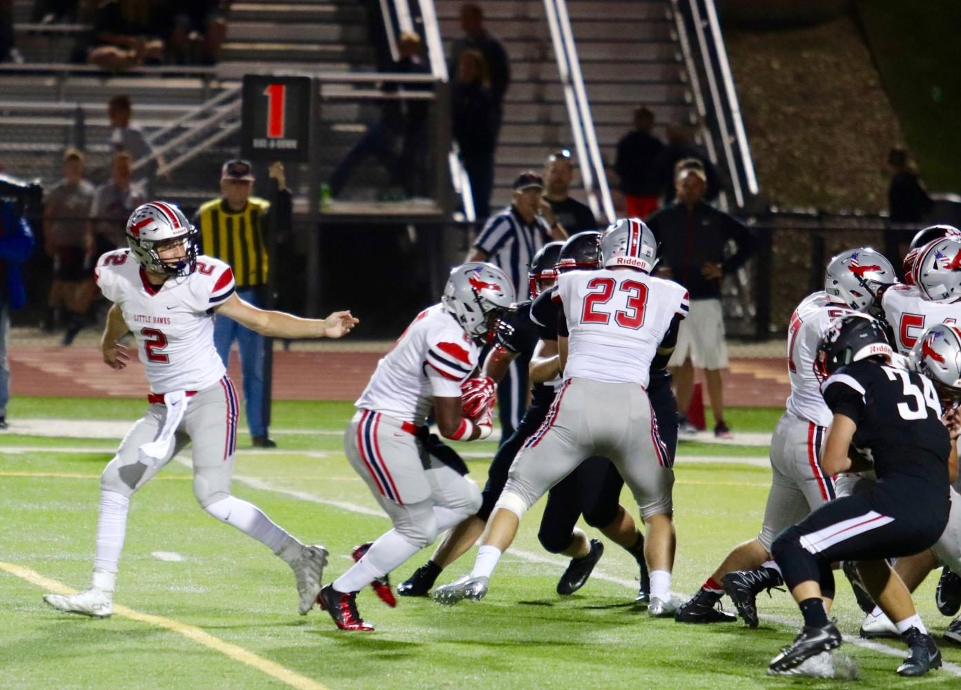 Devontae Foster 18 looks for an opening after receiving the ball from Bryce Hunger 18.