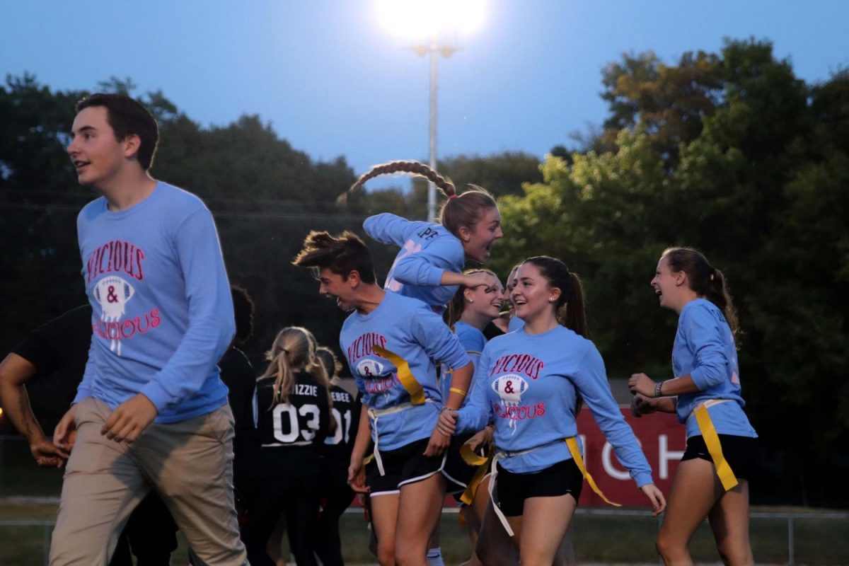 Teammates Madeline Pugh '19 and Naomi Meurice '19 celebrate a touchdown