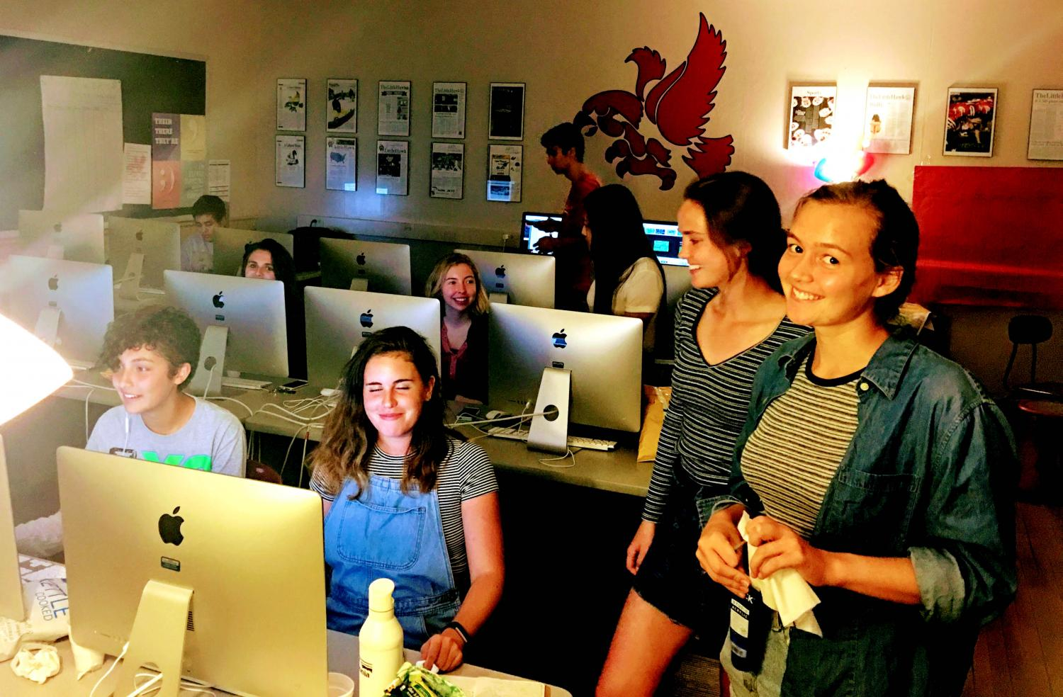 Little Hawk editors Nova Meurice, Lucy McGehee, Sarah Smith and Sofie Lee work on the publication in room 2109.