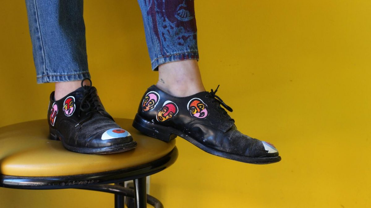 Elise Heck '17 models hand painted shoes featuring Butler's Art