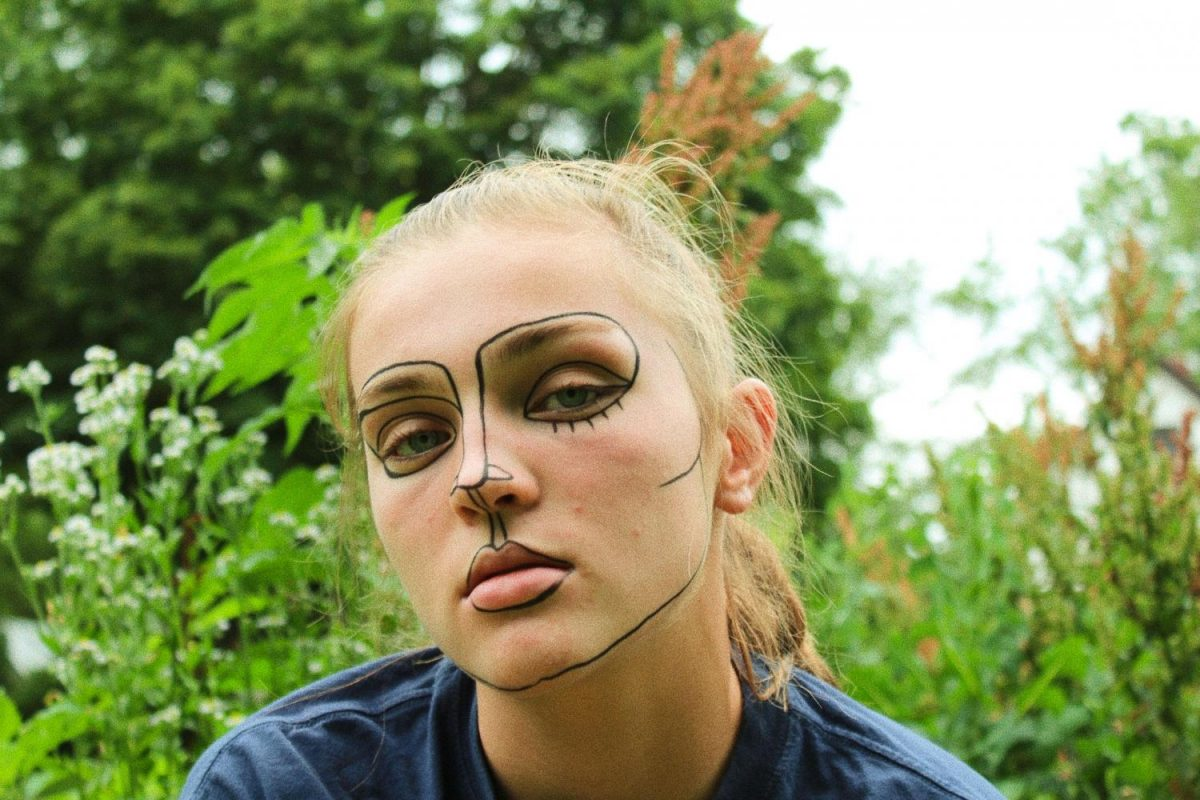 Butler blends her inspiration and art by painting directly onto Madeline Pughs 19 face.