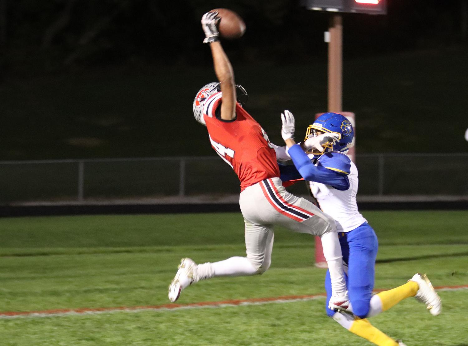 #84 Zach Jones catches a touchdown pass in his final game game against Davenport North where he broke the City High wide receiver record.