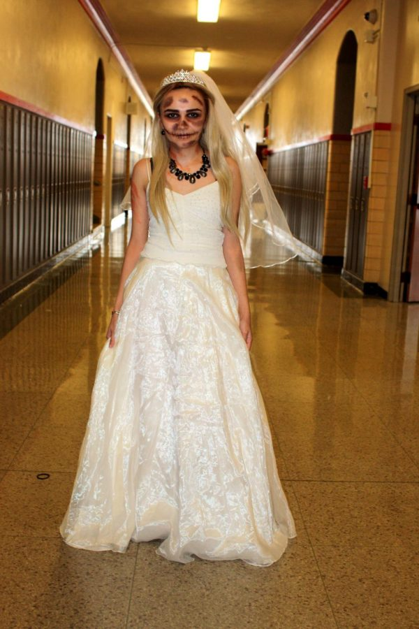 Ghostly bride poses in the hallway.