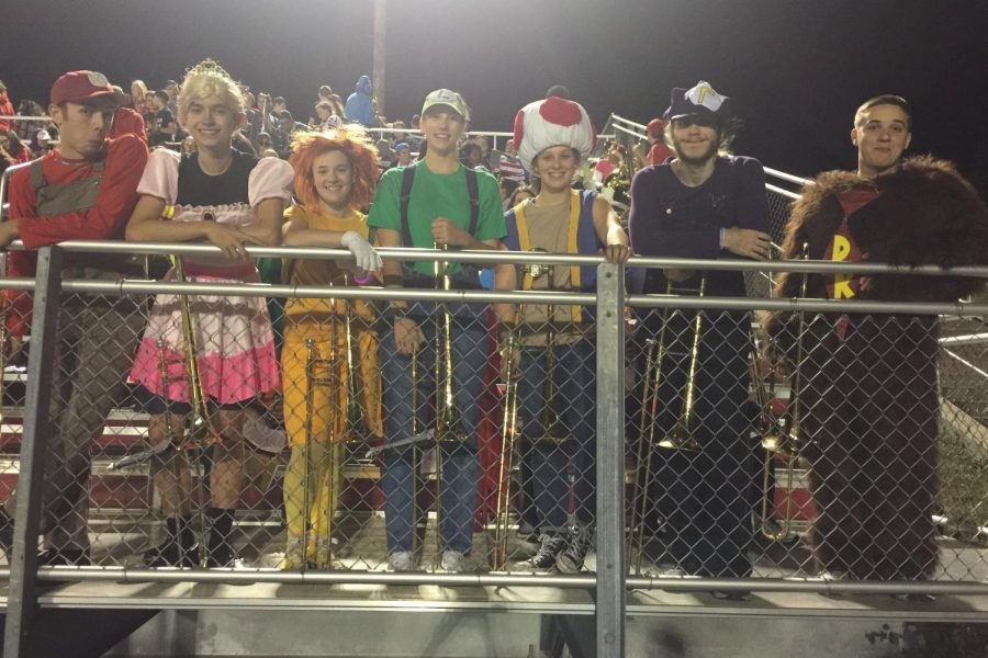 The trombone section dresses as characters from Mario