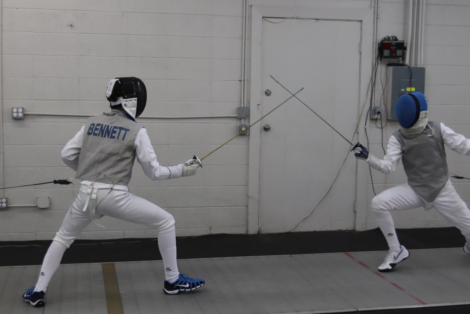Joseph Bennett '20 duels with a fellow fencer at the Iowa City Fencing Club where they train.