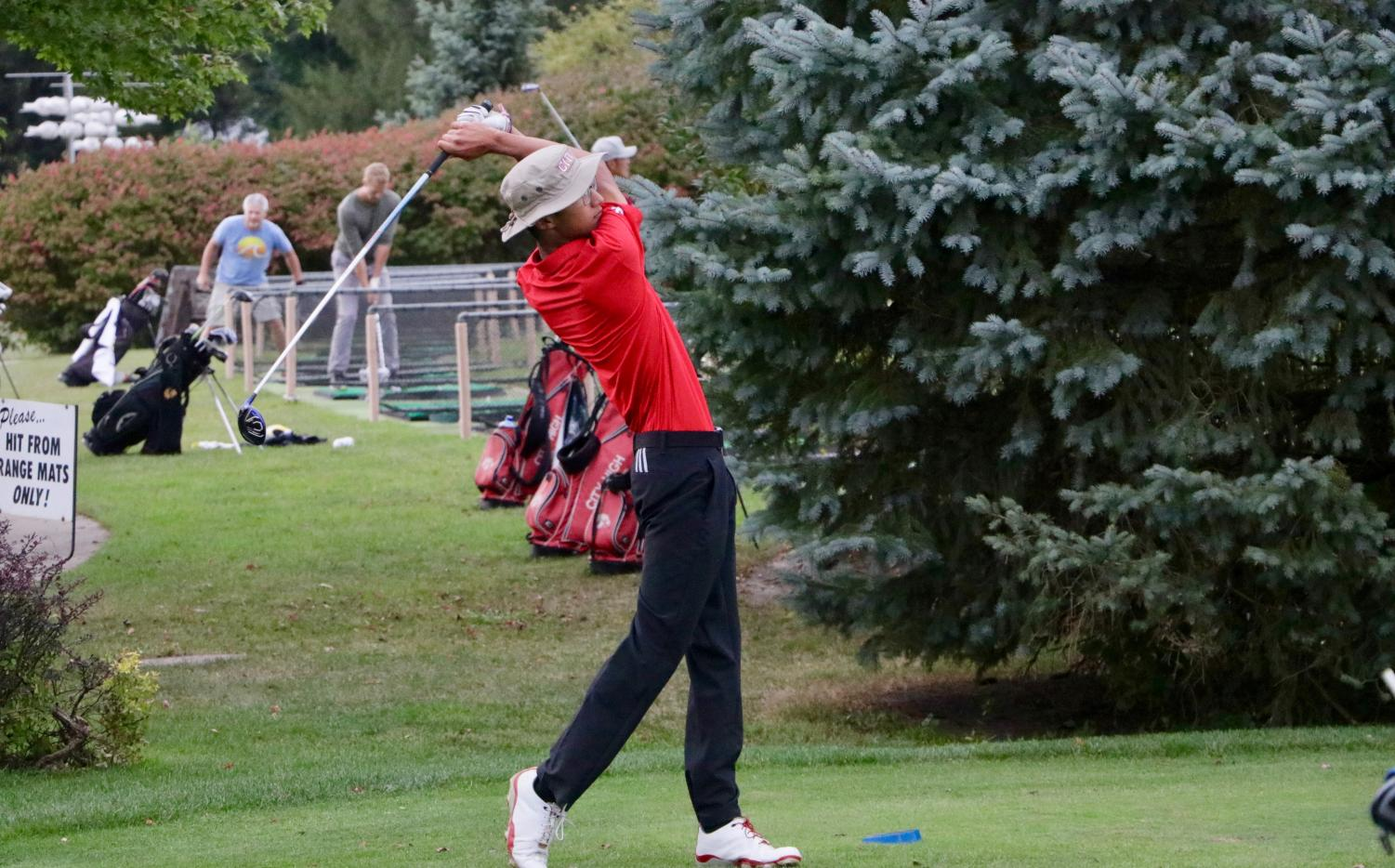 Winston Lui '18 takes a swing during the Little Hawks' meet at the Pleasant Valley golf course.