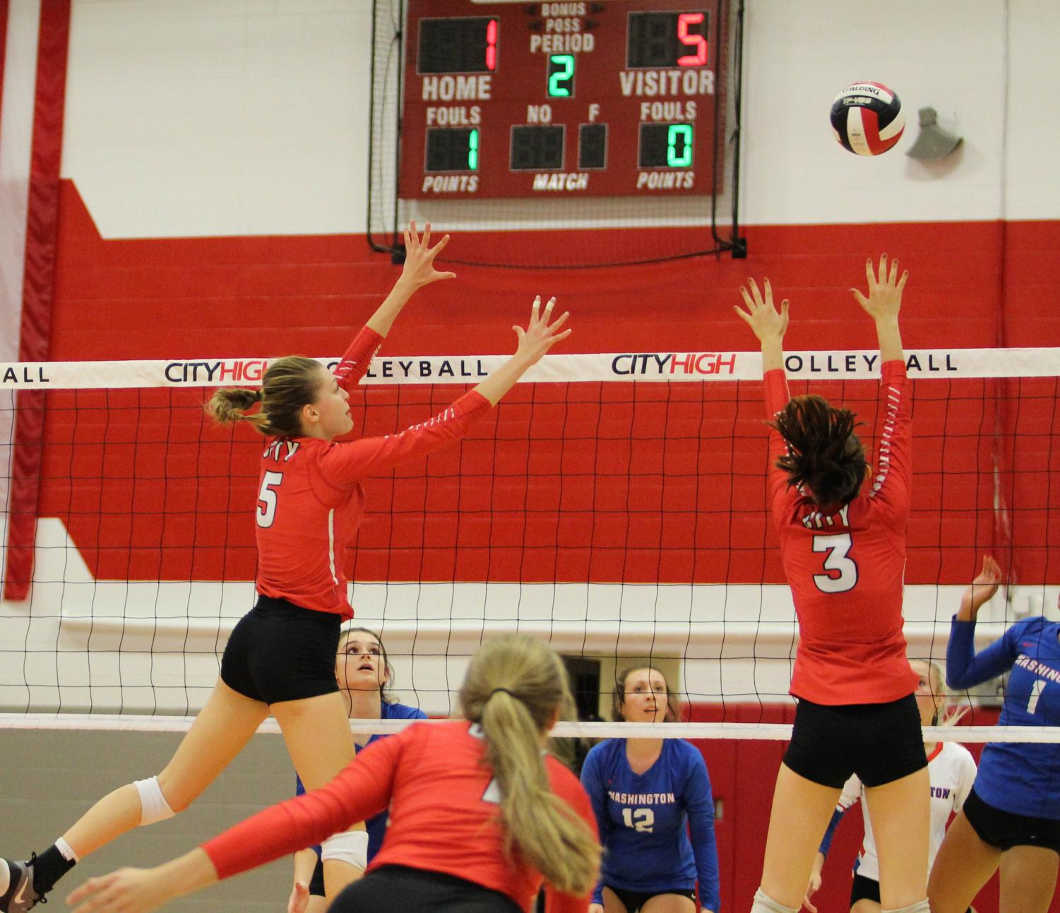 Lindsey Bolton '20 and Mackenzie Murphy '19 team up for a block against Cedar Rapids Washington.