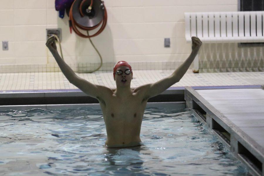Mickale Sadecky '18 celebrates after winning the 50m free