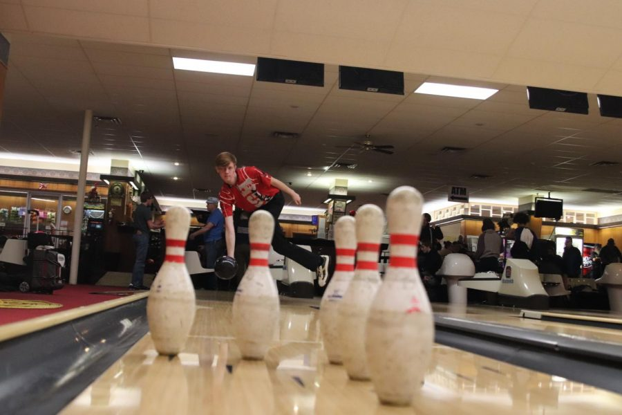 Andrew Franz '18 sends a ball down the lane during the Little Hawks' meeting against Linn-Mar on December 5th.
