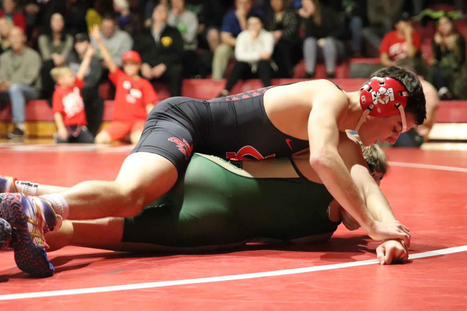 Matt Rew '20 pins his opponent in one minute during the Little Hawks' meet against West High on December 14th.