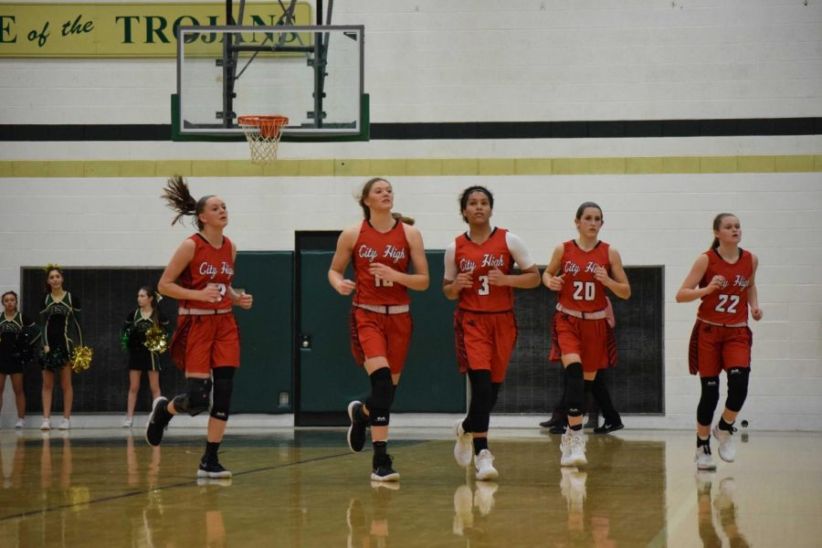 City Girls Take Down West Rivals