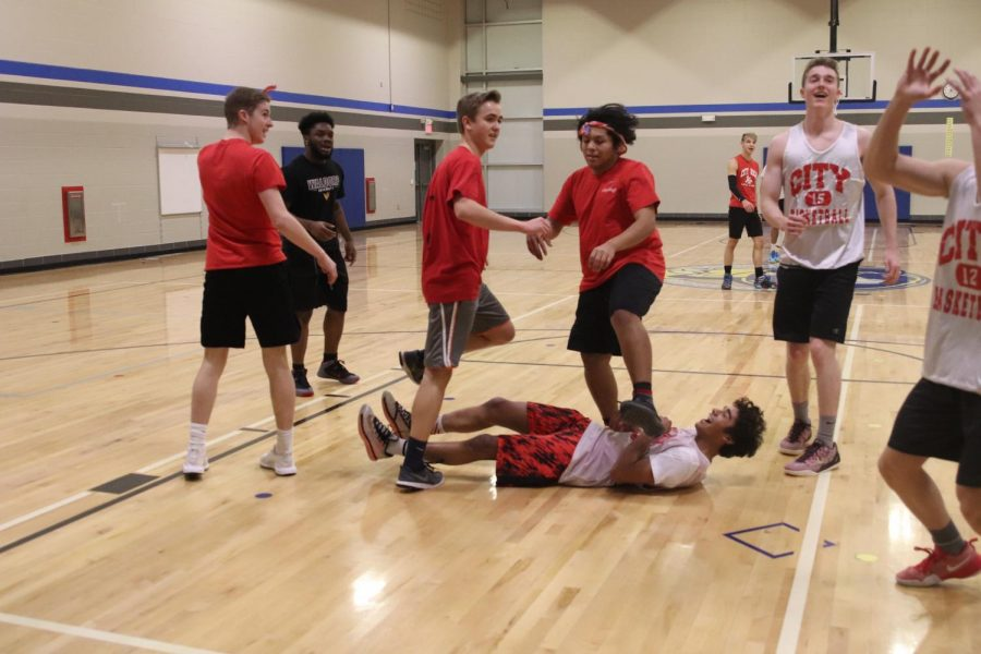 Rec League players look around in confusion after the whistle blows due to a collision between Sam Bloom '18 and his opponent, Jonah Dancer '18.