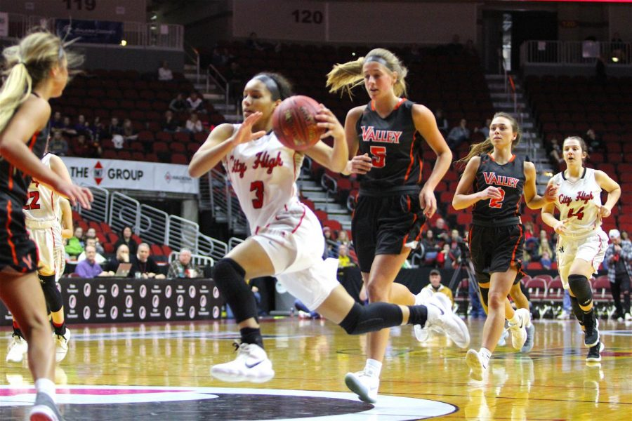 Rose Nkumu '20 takes one to the hoop during the quarter-final State tournament game at Wells Fargo Arena.