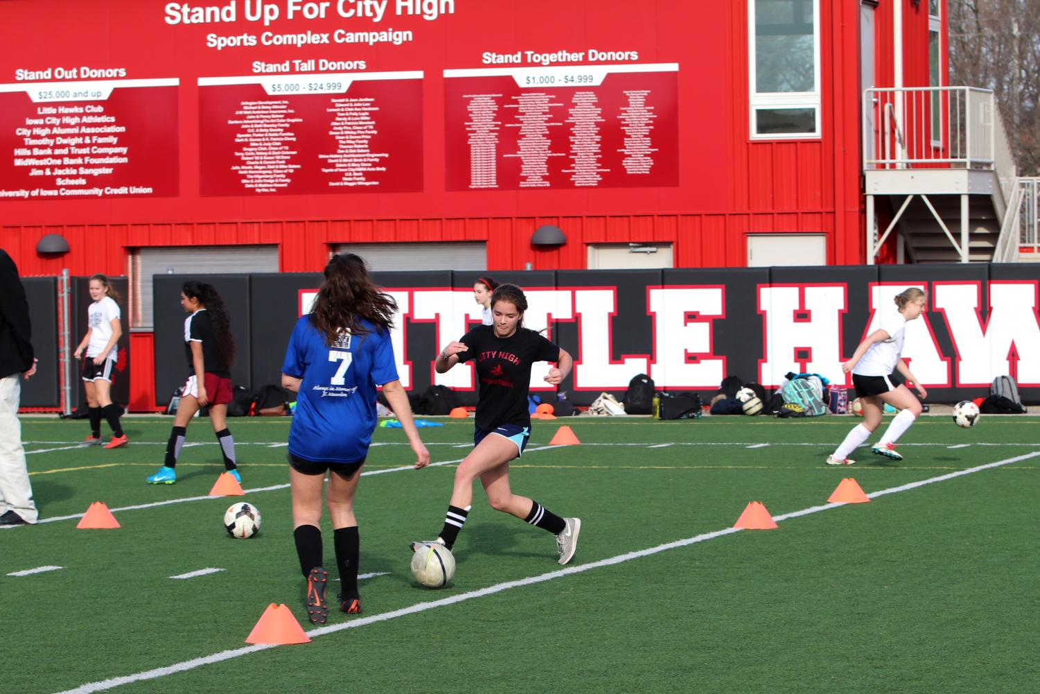 Zoe Hellberg '21 and Kate Wolfe '21 run drills during tryouts