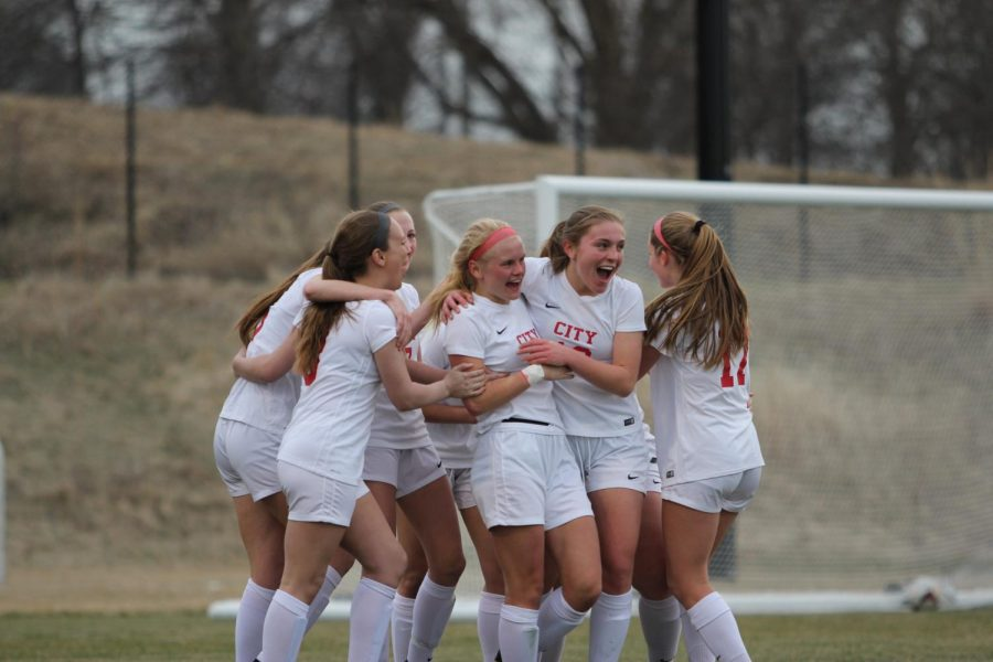 Sydney DePrenger '18's teammates congratulate her after her goal which put the Little Hawks up 3-0 Friday night at the Iowa Soccer Fields.