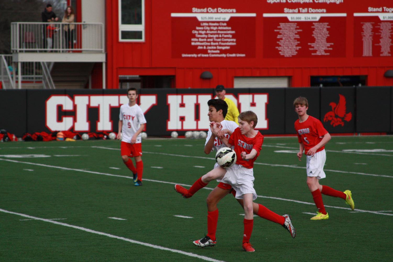 Carlos Tellez '21 tries to steal the ball.
