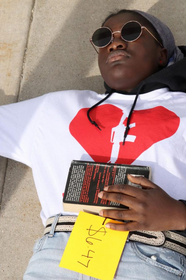 Mariam Keita '20 held Malcolm X's autobiography as she protested.