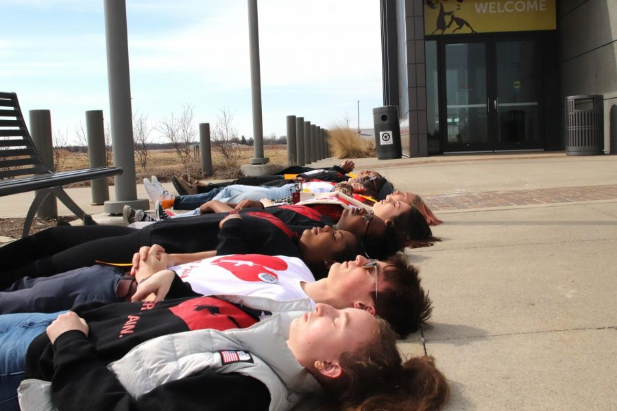 ICCSD schools were closed on Friday, April 20, so students were unable to join in the national walkout. Instead, members of SASS planned their die-ins to coincide with the walkouts.