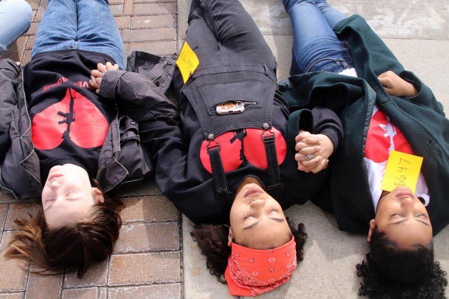 Protesters held hands or linked arms during the die-in as a way to support each other.