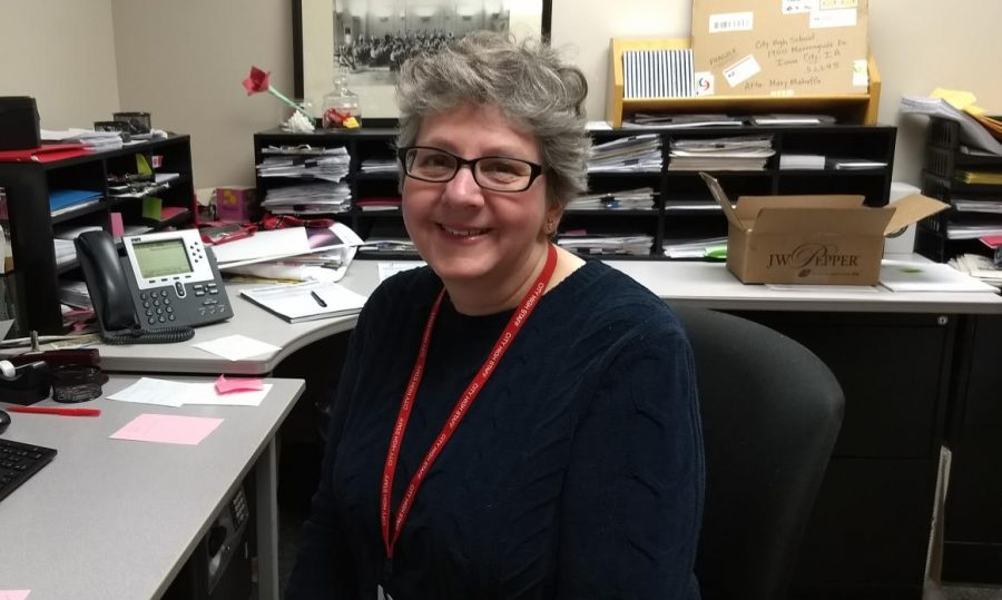 Mrs. Mahaffa sits in the office where she performs her duties as music secretary.