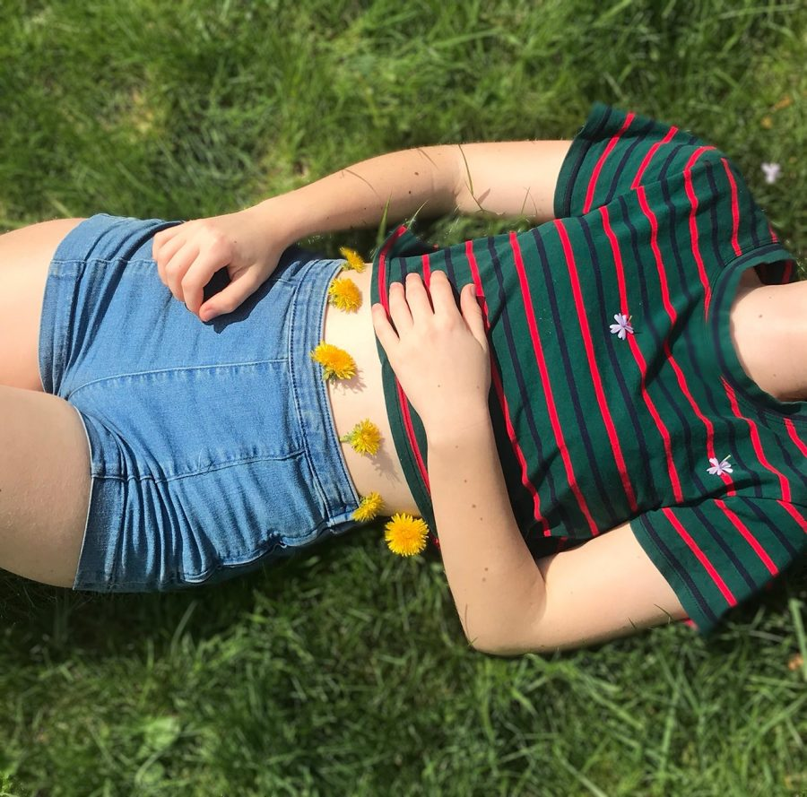 Maria Buri '20 modeling high-waisted shorts and crop tops