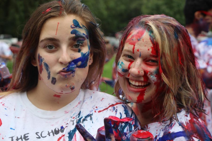 The president and vice president of best buddies squint through the paint.