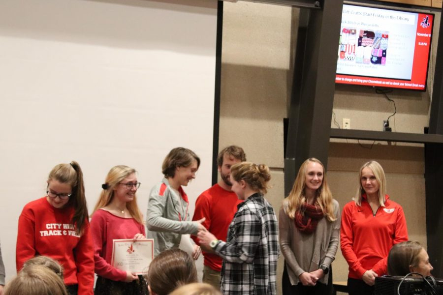 Julia+Veit+%2720+is+congratulated+along+with+fellow+juniors+Mary+Bounds+and+Estella+Brady.