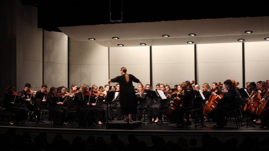 Mrs. Stucky conducts the Symphony Orchestra