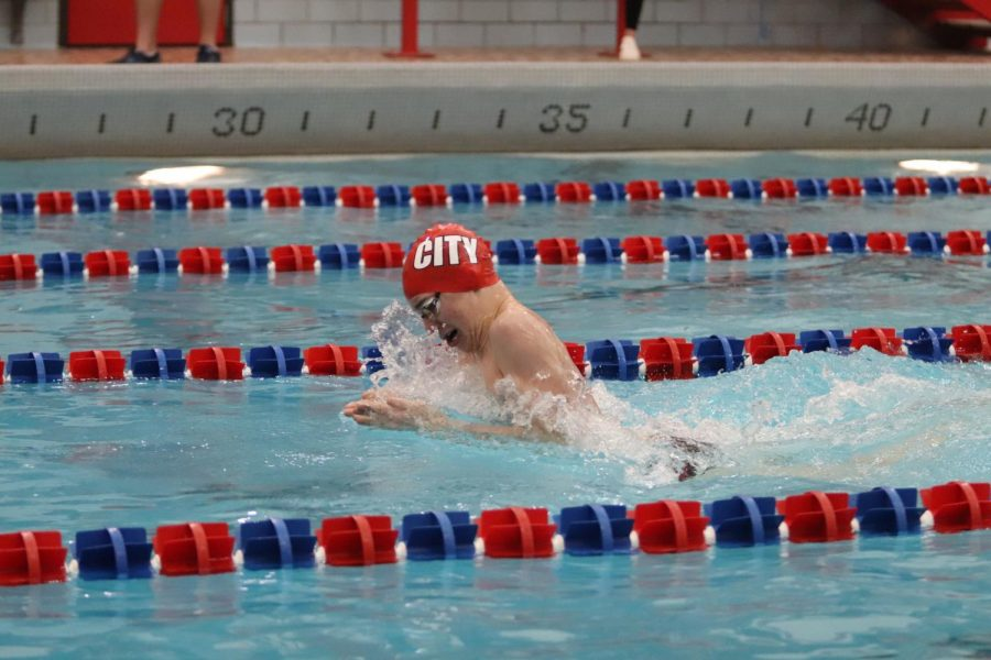 Isaac+Weigel+pulls+during+the+200+medley+relay.