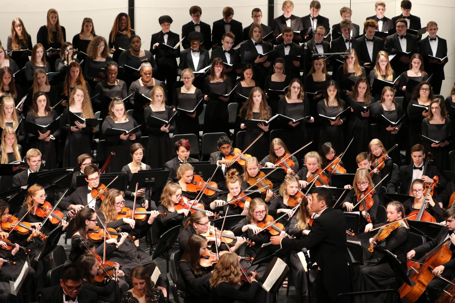 Tyler+Hagy+conducts+the+concert+orchestra+and+advanced+choirs