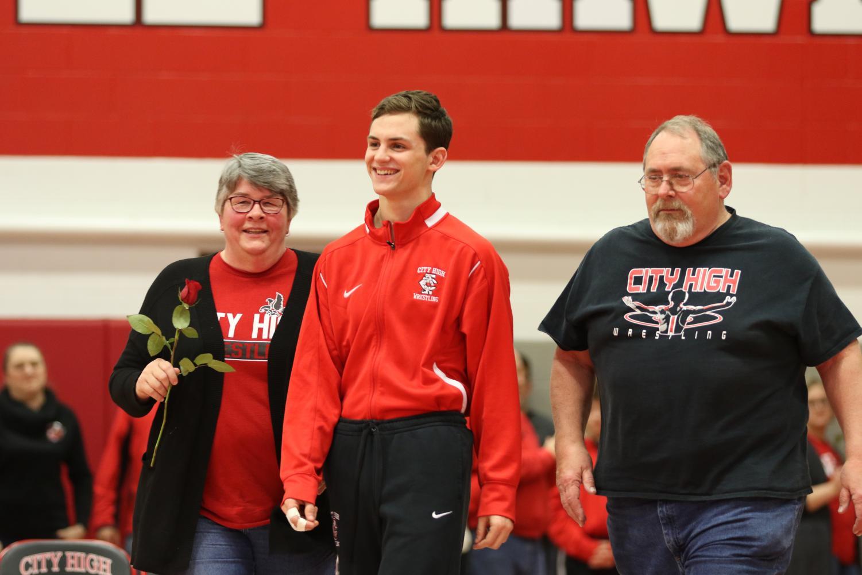 Senior Brandon Lalla escorted by his parents