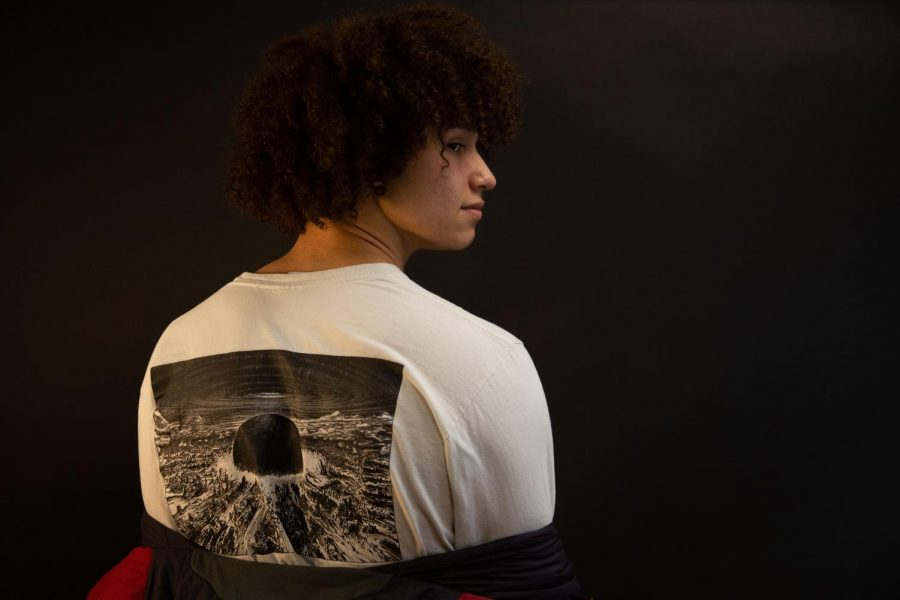 Tariq Murphy poses in a Supreme graphic tee.