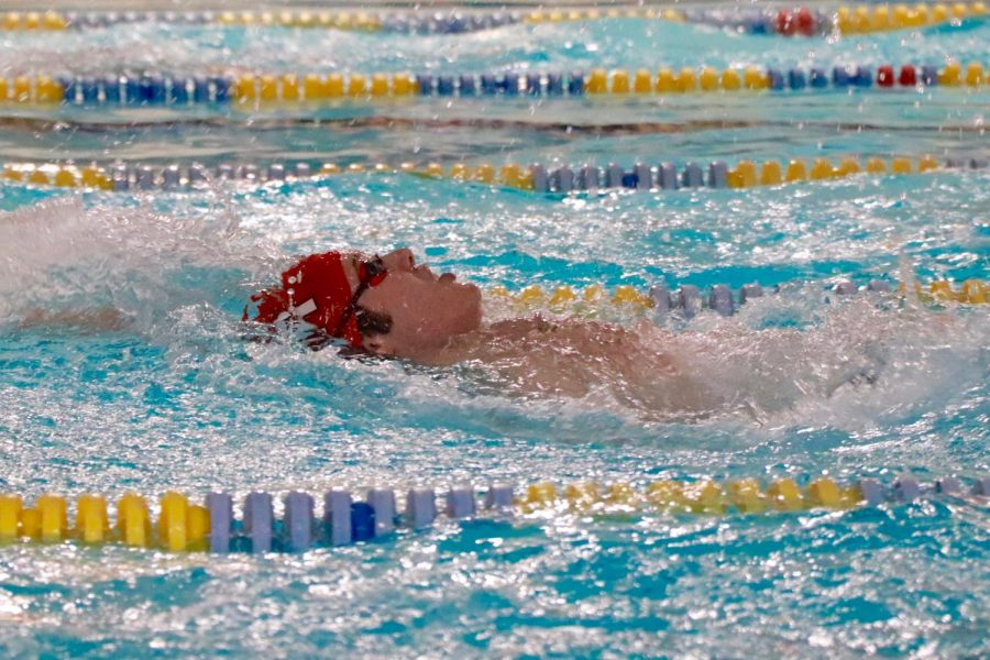 Quinn Kopelman 19 swims the 200 IM, touching with a time of 2:29.56.
