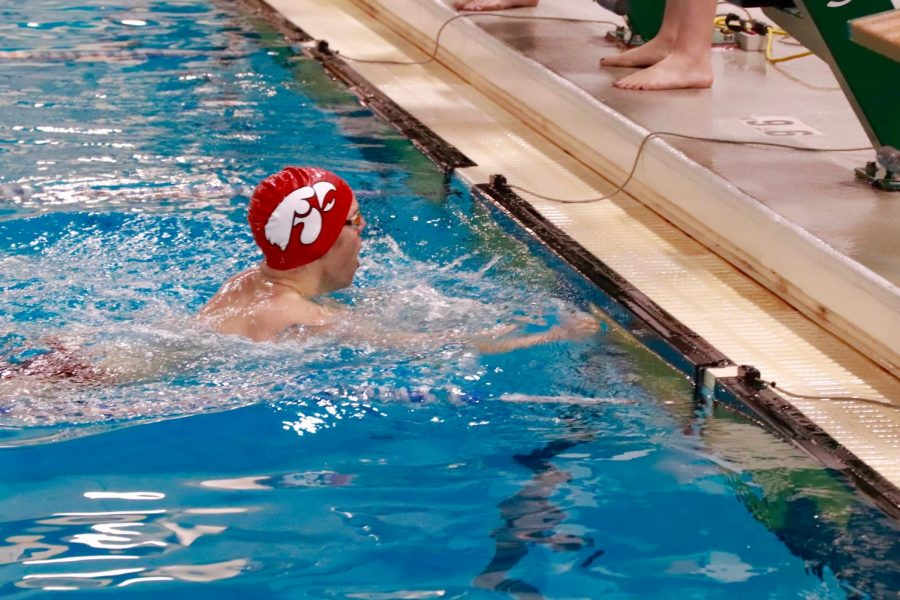 Isaac Weigel '21 finishes first in the 100 breaststroke with a time of 1:02.78.