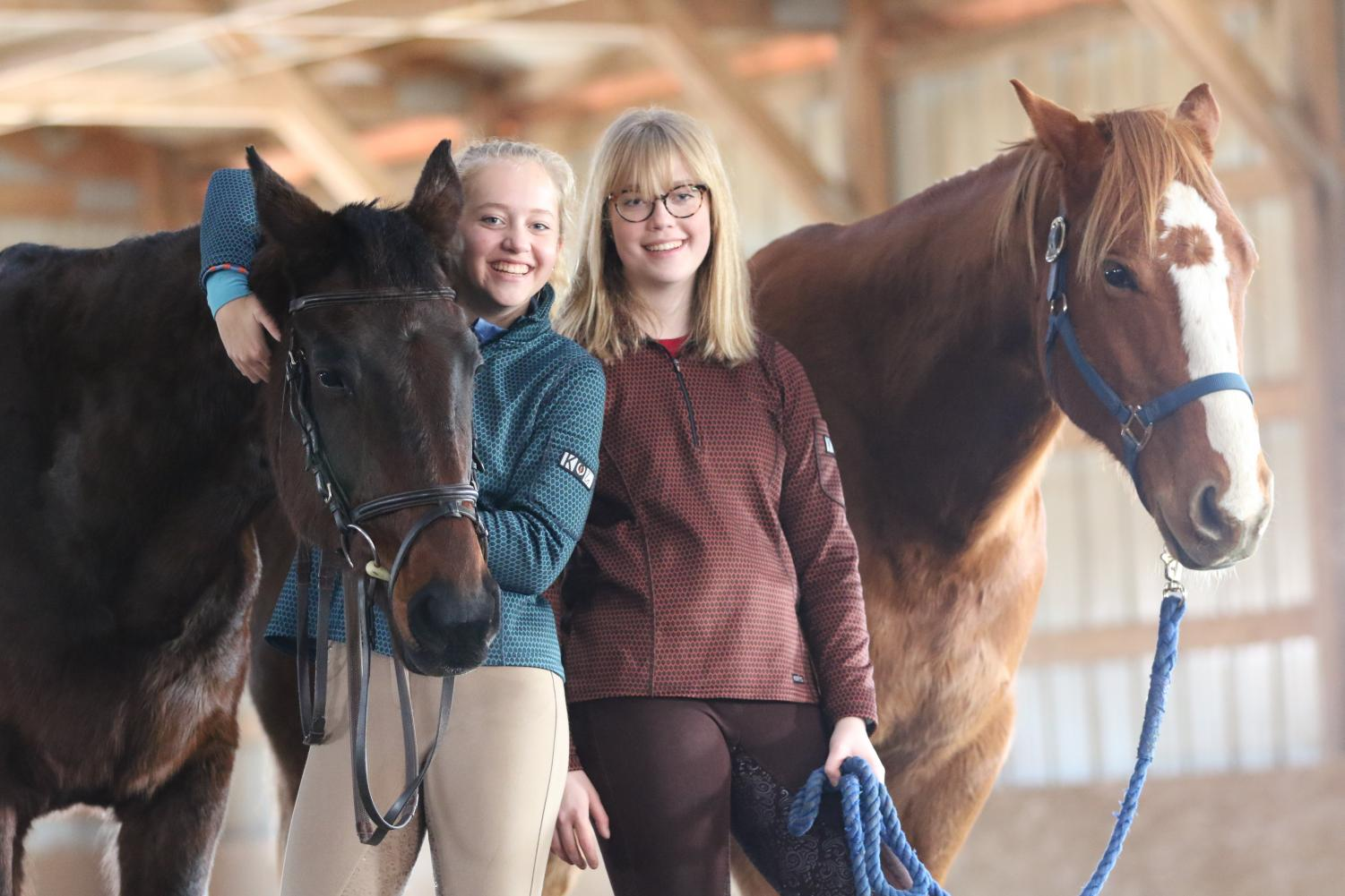Alex '20 and Rachel Marsh '22 with the horses they call friends.