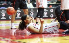 Rose Nkumu 20 hits the floor during Citys State Tournament game at Wells Fargo Arena.   Photo by Lottie Gidal